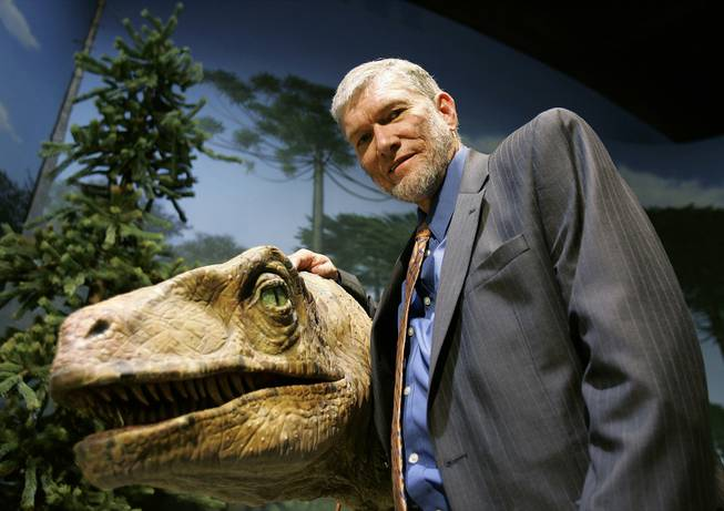 Ken Ham, founder of the nonprofit ministry Answers in Genesis, stands with one of his favorite animatronic dinosaurs during a tour of Creation Museum on Thursday, May 24, 2007, in Petersburg, Ky.