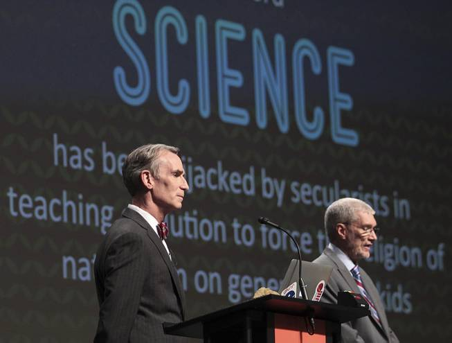 "In this Feb. 4, 2014 photo, Creation Museum head Ken Ham, right, speaks during a debate on evolution with TV's ""Science Guy"" Bill Nye, at the Creation Museum in Petersburg, Ky."