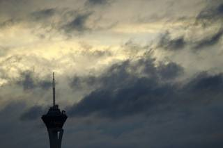 The Stratosphere Tower is silhouetted by a break in the clouds and the setting sun during the afternoon Friday, Feb. 28, 2014.