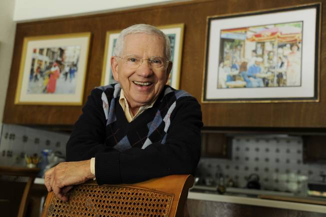 "In this Wednesday, Feb. 26, 2014, photo, actor, artist and singer Robert Clary stands near some of his paintings at his home in Beverly Hills, Calif. Clary, who starred in the sitcom ""Hogan's Heroes,"" turns 88 on Saturday, March 1, 2014."