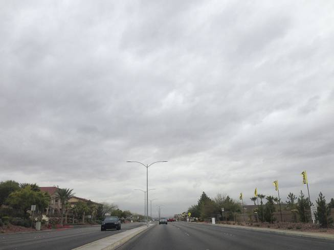 Clouds loom overhead in Henderson threatening much needed rain in the Valley Friday, Feb. 28, 2014.