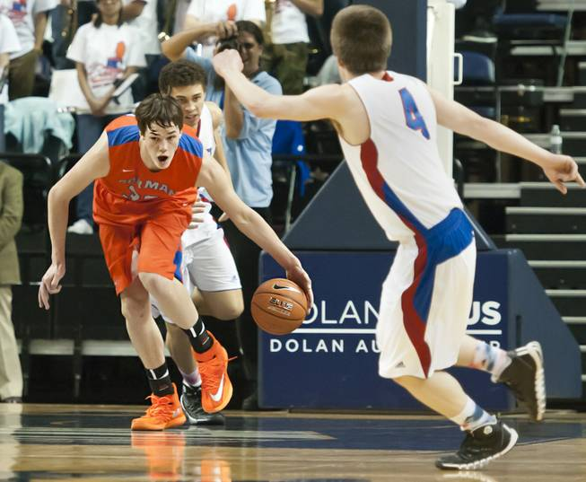 Stephen Zimmerman comes up with a rebound and looks upcourt Thursday, Feb. 27, 2014 as Bishop Gorman defeats Reno 68-27 in the semifinals of the Nevada State Championships at Lawlor Events Center in Reno.