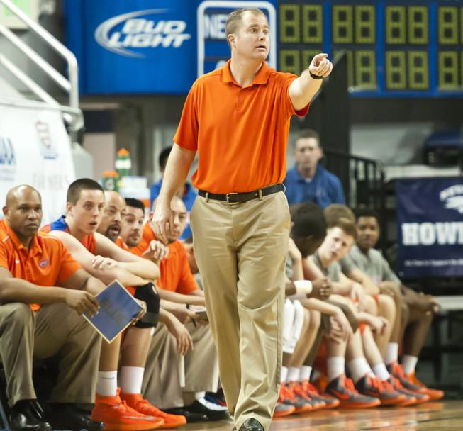 Head coach Grant Rice calls out to his players early in the first half Thursday, Feb. 27, 2014 as Bishop Gorman defeats Reno 68-27 in the semifinals of the Nevada State Championships at Lawlor Events Center in Reno.