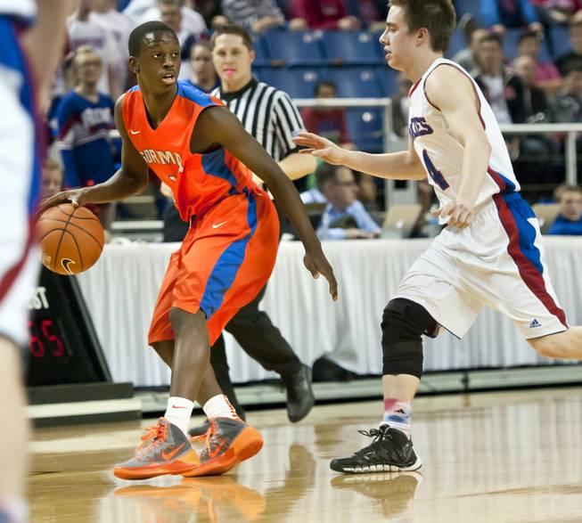 D'Mar Moore protects the ball as his teammates set up a play late in the game Thursday, Feb. 27, 2014 as Bishop Gorman defeats Reno 68-27 in the semifinals of the Nevada State Championships at Lawlor Events Center in Reno.