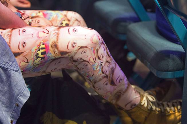 A fan wears tights with images of Miley Cyrus at the Miley Cyrus concert at MGM Grand Garden Arena on Saturday, March 1, 2014, in Las Vegas.