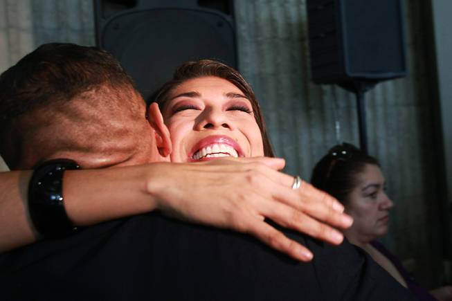Lucy Flores hugs supporter Derek Washington after announcing her candidacy for Lieutenant Governor Saturday, March 1, 2014 at the College of Southern Nevada's Cheyenne campus.