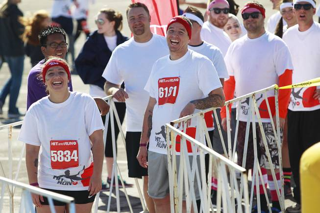 Participants laugh at others while waiting to take on an obstacle during the Hit and Run 5k Saturday, March 1, 2014 at Sam Boyd Stadium. The Hit and Run 5k, a fun run with various obstacles to navigate, is being held or planned in two dozen cities across the country.