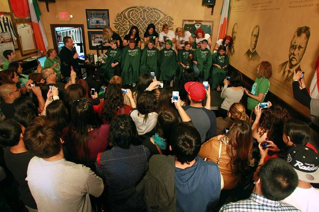 Supporters watch their friends and family members have their heads shaved during the St. Baldrick's fundraiser for cancer Saturday, March 1, 2014 at McMillan's Irish Pub.