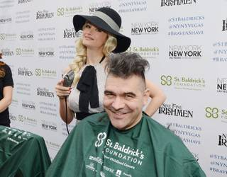 Holly Madison shaves the head of John Katsilometes of The Kats Report in support of St. Baldrick's Foundation's fundraiser for childhood cancer research Saturday, March 1, 2014, at New York-New York's Brooklyn Bridge.