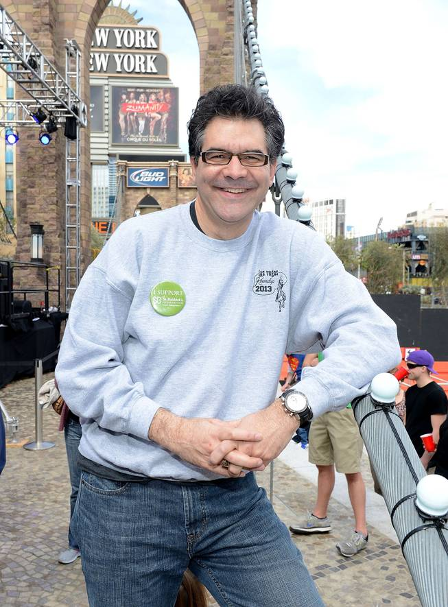 John Katsilometes before his head is shaven by Holly Madison at St. Baldrick's Foundation's fundraiser for childhood cancer research Saturday, March 1, 2014, at New York-New York's Brooklyn Bridge.
