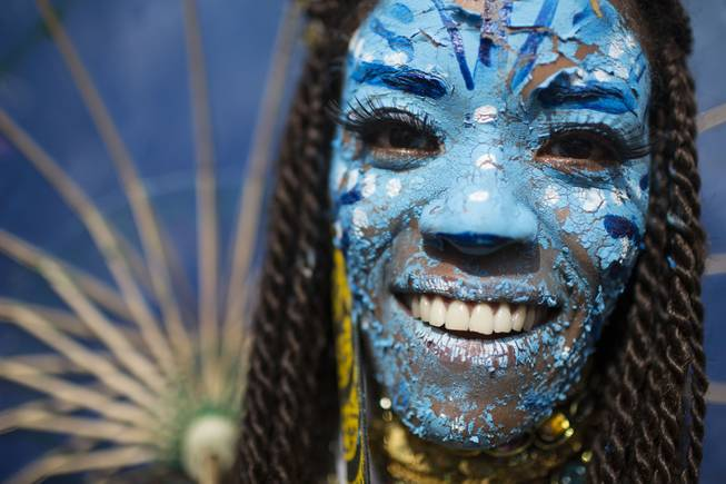 "A reveler dressed as a character from the movie Avatar poses for a photo at the 'Ceu na Terra' block party during Carnival celebration in Rio de Janeiro, Brazil, Saturday, March 1, 2014. Rio de Janeiro's over-the-top Carnival is the highlight of the year for many local residents. Hundreds of thousands of merrymakers will take to Rio's streets in the nearly 500 open-air ""bloco"" parties."