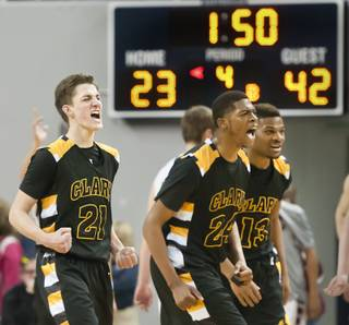 From left: Carter Olsen, Diontae Jones and Ty'Rek Wells let out a roar heading into a timeout as the final minutes tick off the clock Saturday, March 1, 2014 as Clark High School defeated Elko High School 43-25 winning the Division I-A state championship at Lawlor Event Center in Reno.