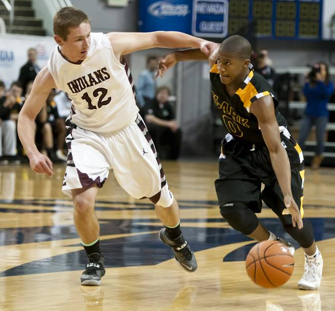 Colby Jackson, right, dribbles around Cody Nielsen on his way to the paint Saturday, March 1, 2014 as Clark High School defeated Elko High School 43-25 winning the Division I-A state championship at Lawlor Event Center in Reno.