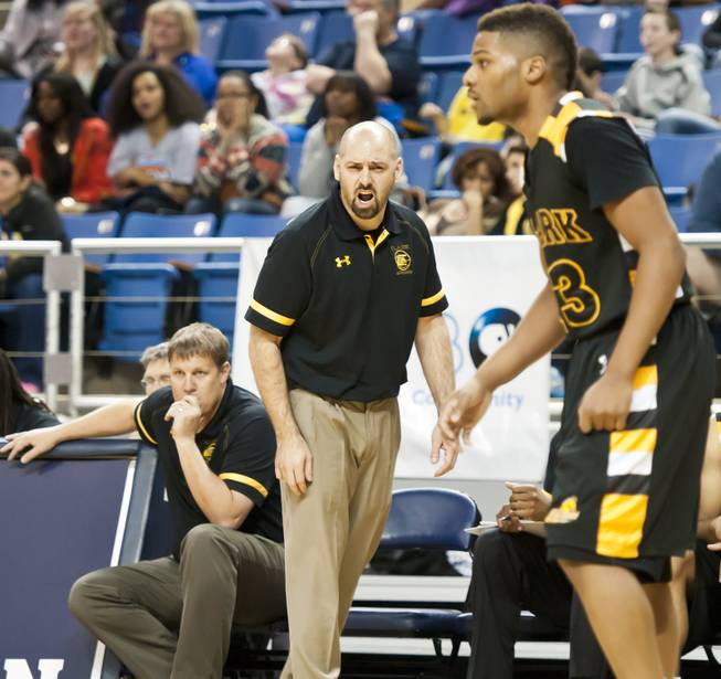 Head coach Chad Beeten calls out to his players from the sideline Saturday, March 1, 2014 as Clark High School defeated Elko High School 43-25 winning the Division I-A state championship at Lawlor Event Center in Reno.