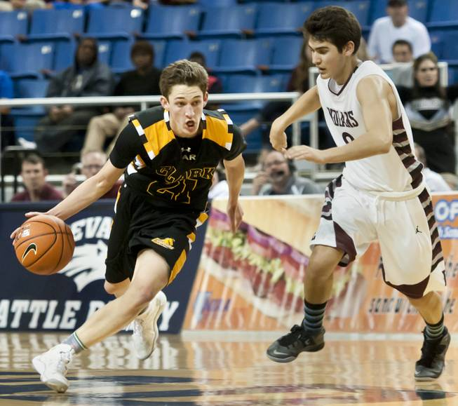 Carter Olsen, left, works into the lane with a defender on his hip Saturday, March 1, 2014 as Clark High School defeated Elko High School 43-25 winning the Division I-A state championship at Lawlor Event Center in Reno.