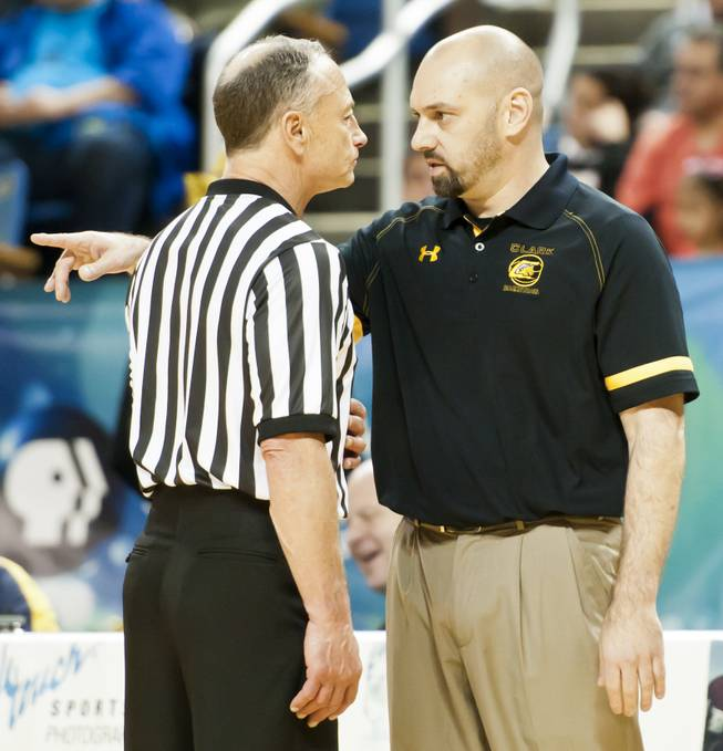 Head coach Chad Beeten speaks with a referee during a timeout in the second half Saturday, March 1, 2014 as Clark High School defeated Elko High School 43-25 winning the Division I-A state championship at Lawlor Event Center in Reno.