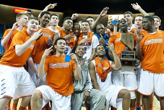 Bishop Gorman celebrates with their third consecutive state championship trophy Friday, Feb. 28, 2014 as Bishop Gorman defeated Canyon Springs 71-58 in the Nevada state championship game at Lawlor Event Center in Reno.