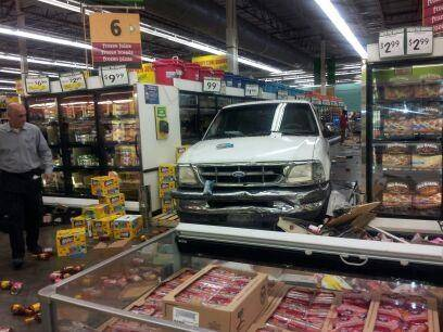 A man surveys the damage Saturday afternoon after a woman crashed a pickup truck into the Food 4 Less grocery store at Eastern and Sahara avenues.