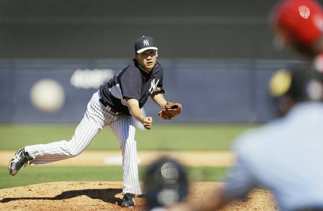 New York Yankees pitcher Masahiro Tanaka throws a pitch during the sixth inning of an exhibition baseball game against the Philadelphia Phillies Saturday, March 1, 2014, in Tampa, Fla.