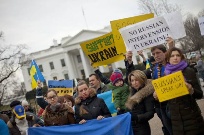 Demonstrators gather outside the White House in Washington on Saturday, Feb. 1, 2014. Russian troops took over Crimea as the parliament in Moscow gave President Vladimir Putin a green light Saturday to use the military to protect Russian interests in Ukraine.