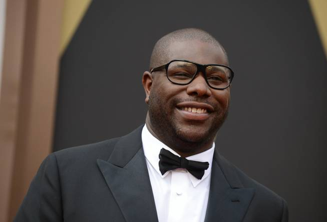 Director Steve McQueen arrives at the Oscars on Sunday, March 2, 2014, at the Dolby Theatre in Los Angeles.  (Photo by Jordan Strauss/Invision/AP)