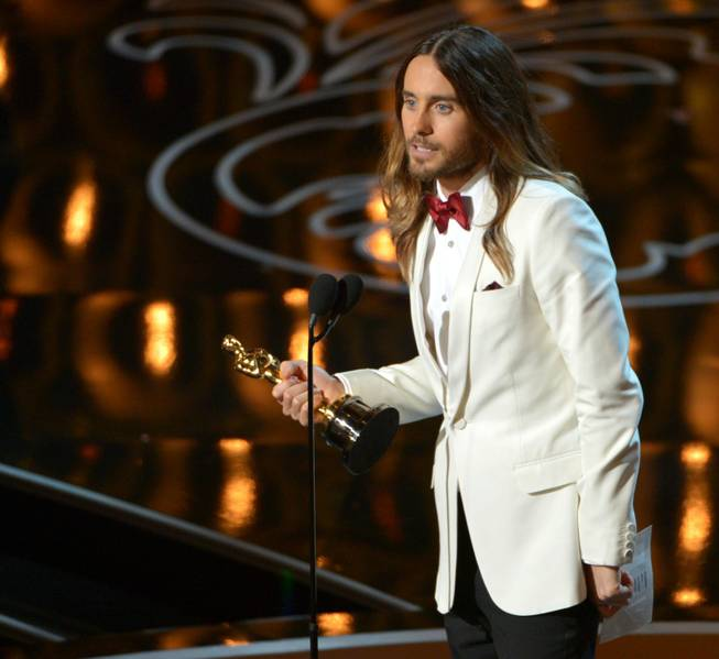 "Jared Leto accepts the award for best actor in a supporting role for ""Dallas Buyers Club"" during the Oscars at the Dolby Theatre on Sunday, March 2, 2014, in Los Angeles."