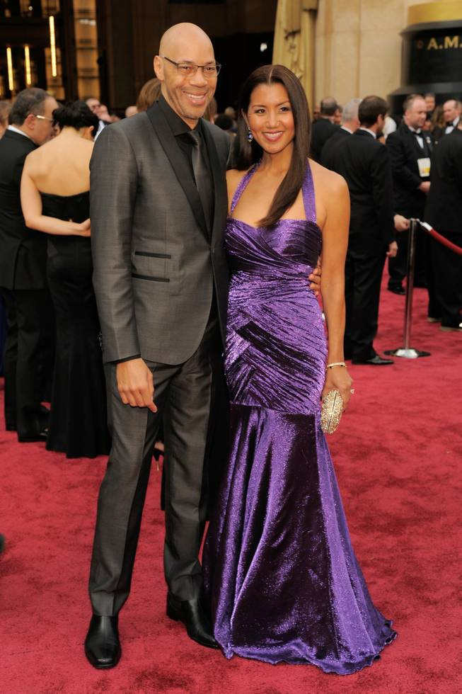 John Ridley, left, and Gayle Ridley arrives at the Oscars on Sunday, March 2, 2014, at the Dolby Theatre in Los Angeles.  (Photo by Chris Pizzello/Invision/AP)