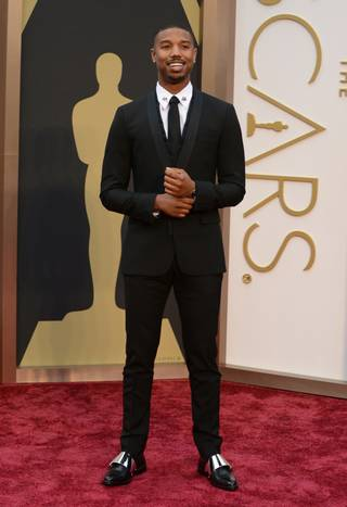 Michael B. Jordan arrives at the Oscars on Sunday, March 2, 2014, at the Dolby Theatre in Los Angeles.  (Photo by Jordan Strauss/Invision/AP)