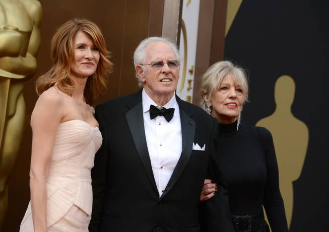 From left, Laura Dern, Bruce Dern and Andrea Beckett arrive at the Oscars on Sunday, March 2, 2014, at the Dolby Theatre in Los Angeles.  (Photo by Jordan Strauss/Invision/AP)