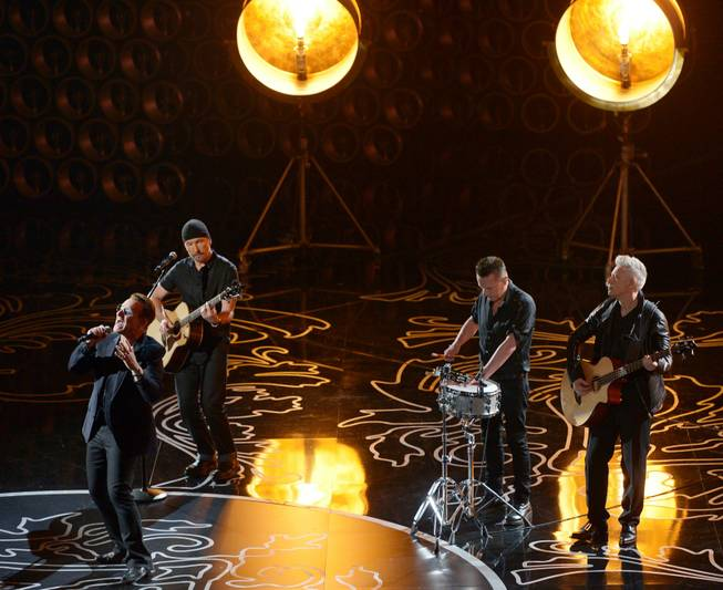 Bono, from left, The Edge, Larry Mullen, Jr., and Adam Clayton of U2 perform during the Oscars at the Dolby Theatre on Sunday, March 2, 2014, in Los Angeles.  (Photo by John Shearer/Invision/AP)