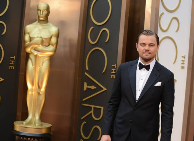 Leonardo DiCaprio arrives at the Oscars on Sunday, March 2, 2014, at the Dolby Theater in Los Angeles.
