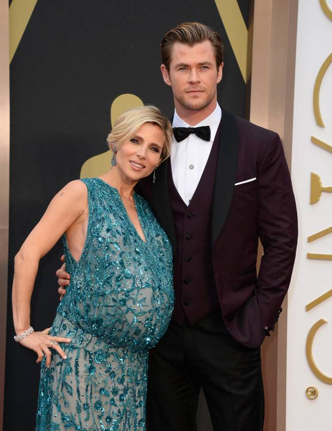Elsa Pataky, left, and Chris Hemsworth arrive at the Oscars on Sunday, March 2, 2014, at the Dolby Theatre in Los Angeles.