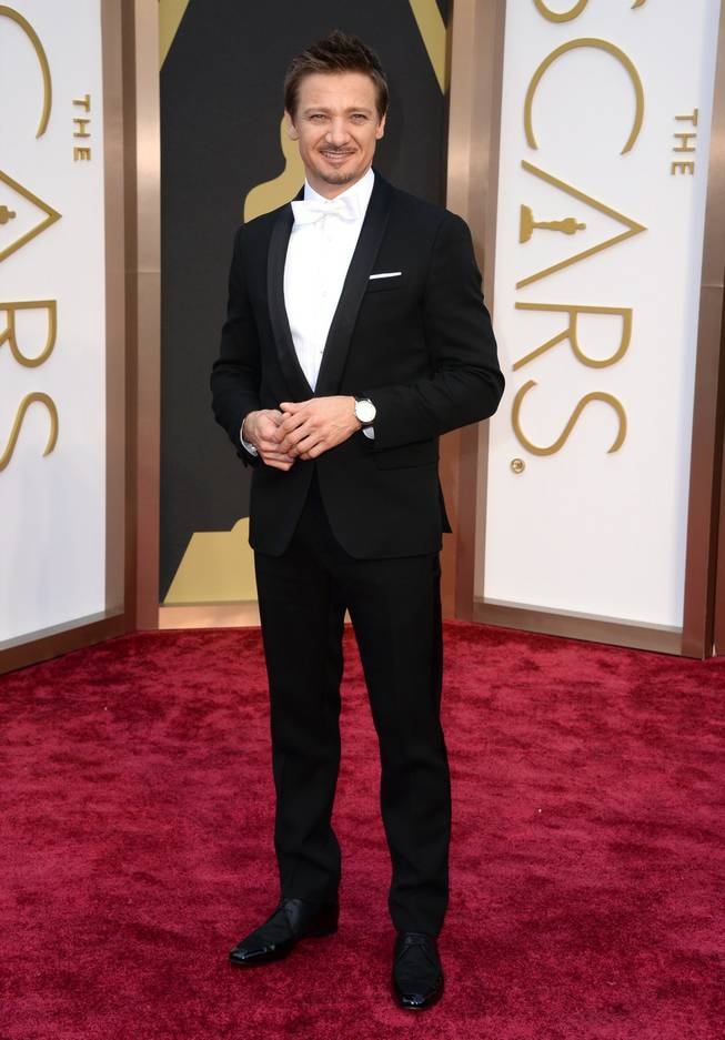 Jeremy Renner arrives at the Oscars on Sunday, March 2, 2014, at the Dolby Theatre in Los Angeles.  (Photo by Jordan Strauss/Invision/AP)