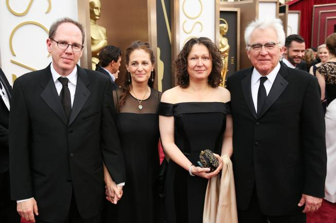Albert Berger, from left, Ellen Steloff, Annette Yerxa and Ron Yerxa arrive at the Oscars on Sunday, March 2, 2014, at the Dolby Theatre in Los Angeles.  (Photo by Matt Sayles/Invision/AP)