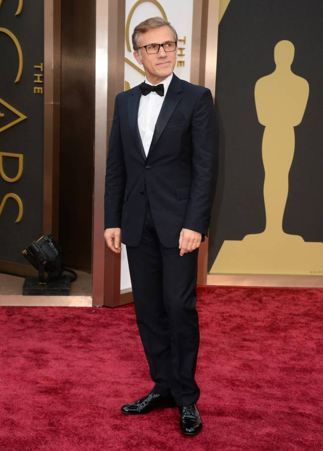 Christoph Waltz arrives at the Oscars on Sunday, March 2, 2014, at the Dolby Theatre in Los Angeles.  (Photo by Jordan Strauss/Invision/AP)