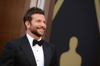 Bradley Cooper arrives at the Oscars on Sunday, March 2, 2014, at the Dolby Theatre in Los Angeles.  (Photo by Jordan Strauss/Invision/AP)