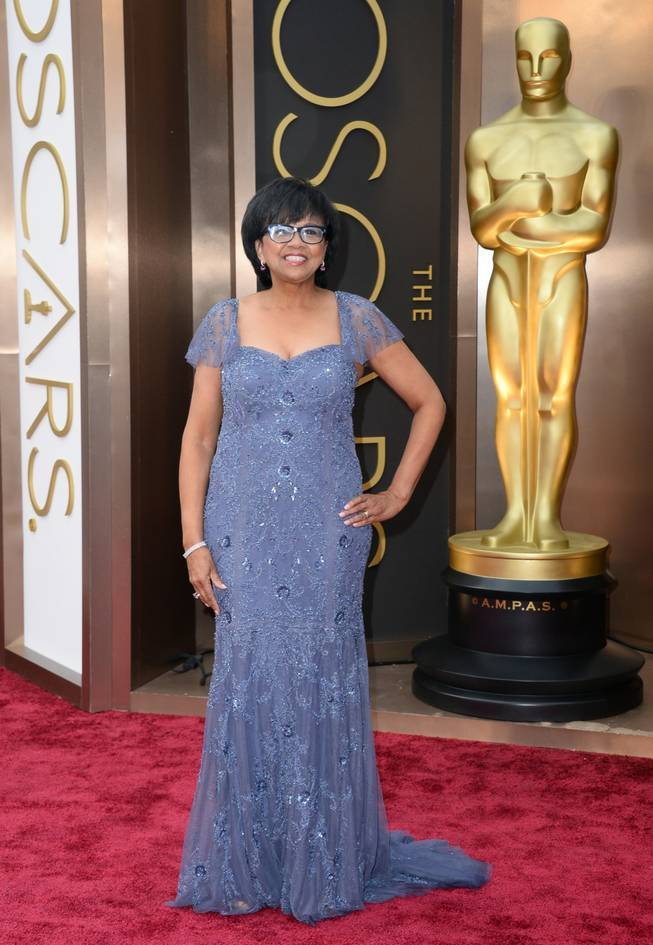 Cheryl Boone Isaacs arrives at the Oscars on Sunday, March 2, 2014, at the Dolby Theatre in Los Angeles.  (Photo by Jordan Strauss/Invision/AP)