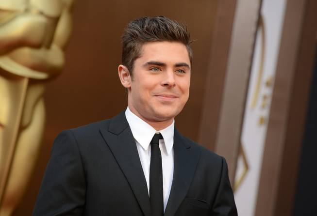 Zac Efron arrives at the Oscars on Sunday, March 2, 2014, at the Dolby Theatre in Los Angeles.  (Photo by Jordan Strauss/Invision/AP)