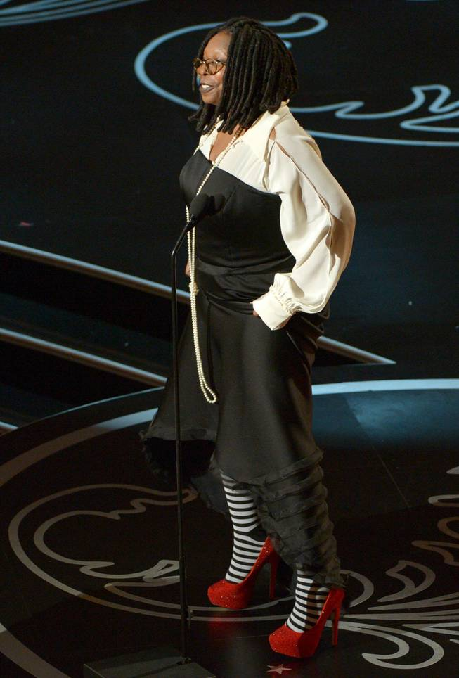 Whoopi Goldberg speaks during the Oscars at the Dolby Theatre on Sunday, March 2, 2014, in Los Angeles.  (Photo by John Shearer/Invision/AP)
