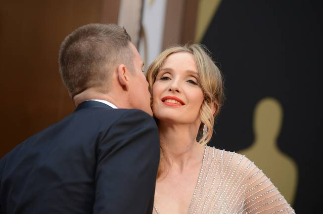 Ethan Hawke, left, and Julie Delpy arrive at the Oscars on Sunday, March 2, 2014, at the Dolby Theatre in Los Angeles.  (Photo by Jordan Strauss/Invision/AP)