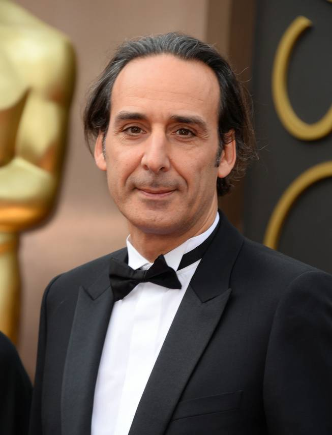 Alexandre Desplat arrives at the Oscars on Sunday, March 2, 2014, at the Dolby Theatre in Los Angeles.  (Photo by Jordan Strauss/Invision/AP)