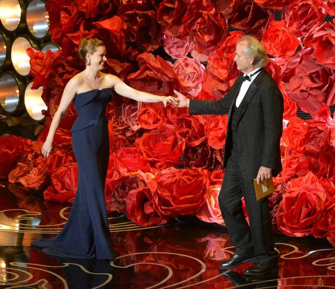 Amy Adams, left, and Bill Murray walk on stage during the Oscars at the Dolby Theatre on Sunday, March 2, 2014, in Los Angeles.  (Photo by John Shearer/Invision/AP)