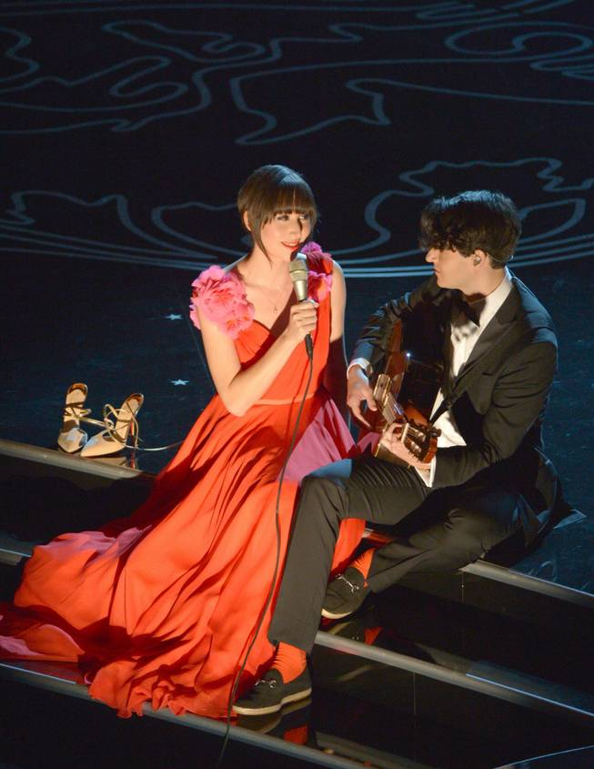 Karen O, left, and Ezra Koenig perform during the Oscars at the Dolby Theatre on Sunday, March 2, 2014, in Los Angeles.  (Photo by John Shearer/Invision/AP)