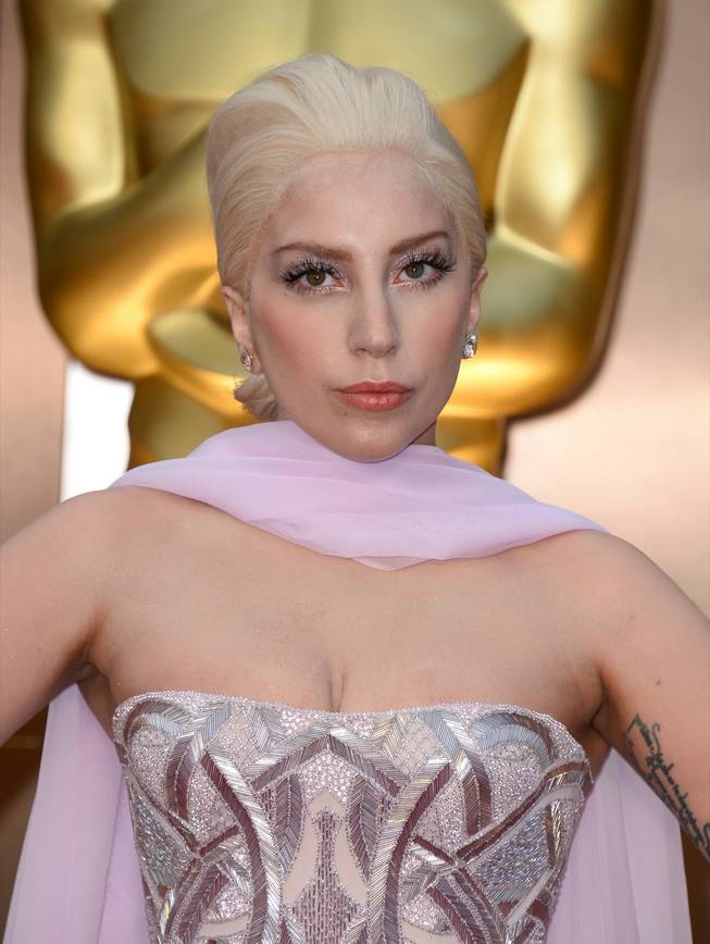 Lady Gaga arrives at the Oscars on Sunday, March 2, 2014, at the Dolby Theater in Los Angeles.