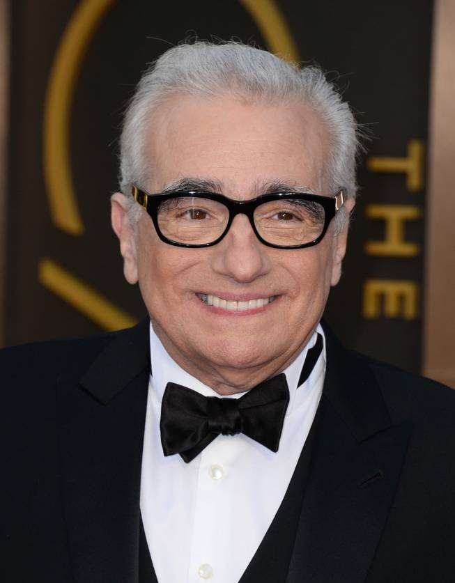 Martin Scorsese arrives at the Oscars on Sunday, March 2, 2014, at the Dolby Theatre in Los Angeles.  (Photo by Jordan Strauss/Invision/AP)