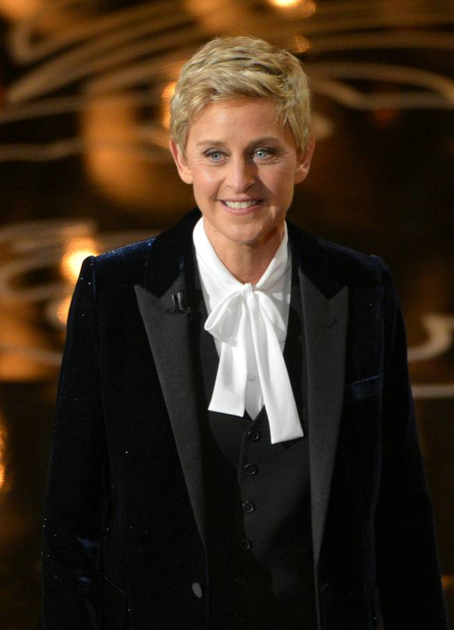 Host Ellen DeGeneres speaks on stage during the Oscars at the Dolby Theatre on Sunday, March 2, 2014, in Los Angeles.  (Photo by John Shearer/Invision/AP)