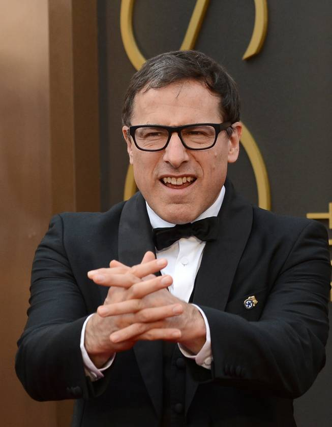 David O. Russell arrives at the Oscars on Sunday, March 2, 2014, at the Dolby Theatre in Los Angeles.  (Photo by Jordan Strauss/Invision/AP)