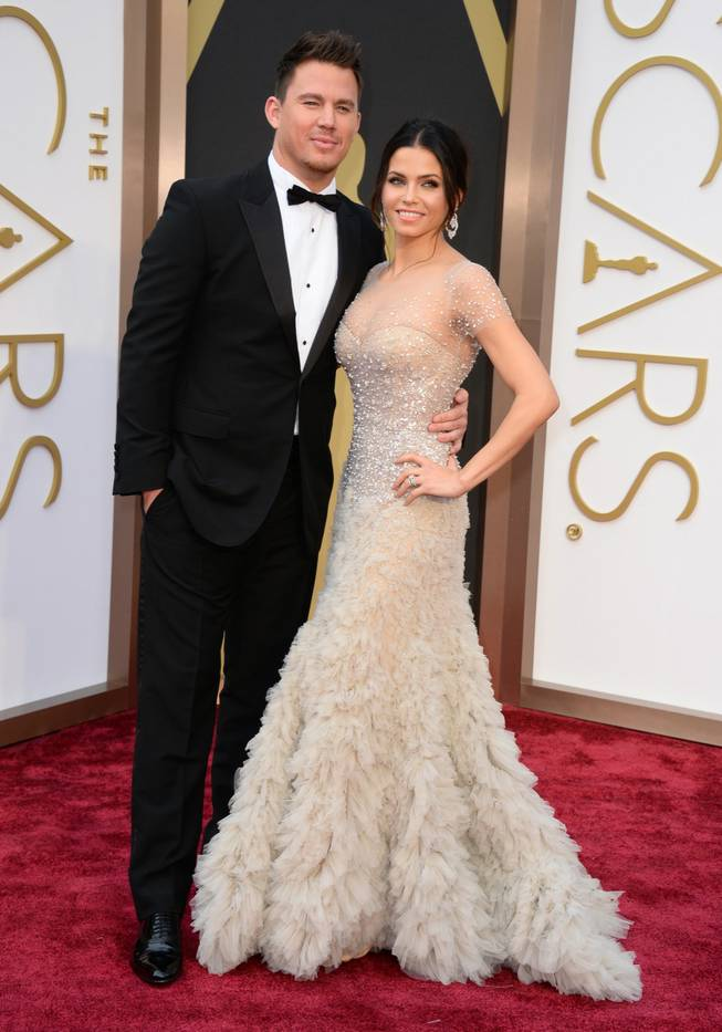 Channing Tatum, left, and Jenna Dewan arrive at the Oscars on Sunday, March 2, 2014, at the Dolby Theatre in Los Angeles.  (Photo by Jordan Strauss/Invision/AP)