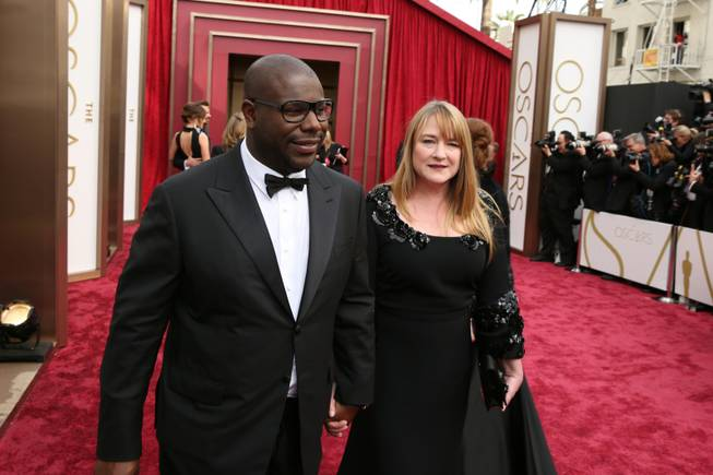 Steve McQueen, left, and Bianca Stigter arrive at the Oscars on Sunday, March 2, 2014, at the Dolby Theatre in Los Angeles.  (Photo by Matt Sayles/Invision/AP)