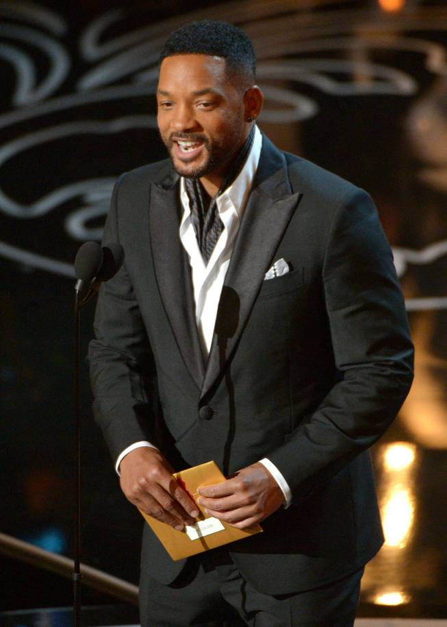 Will Smith speaks on stage during the Oscars at the Dolby Theatre on Sunday, March 2, 2014, in Los Angeles.  (Photo by John Shearer/Invision/AP)